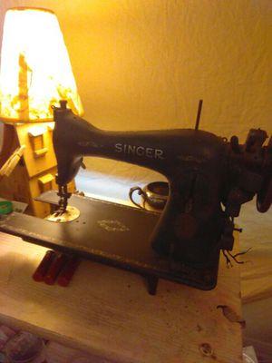 Old worn down Singer sewing machine