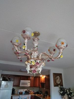 Antiques, pictures and a ceiling lamp