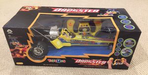 Remote controlled yellow kids dragster racing car