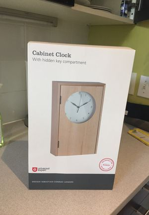 Cabinet clock for storing keys