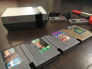 THE ORIGINAL NINTENDO NES SYSTEM. WITH MULTI CART GAME AND ACCESSORIES.