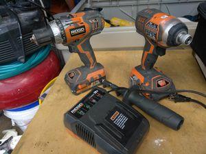 Un juego de driles Ridgid exelentes condiciones con dos bateria y su cargador y su bolsa