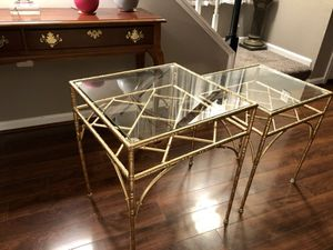 2 golden bronze frame glass top end tables