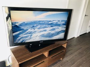 """TV 55"""" Samsung with table and DVD"""