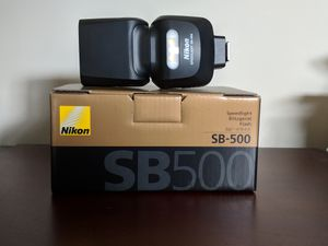 Nikon SB-500 speed light. Brand new, in excellent condition.