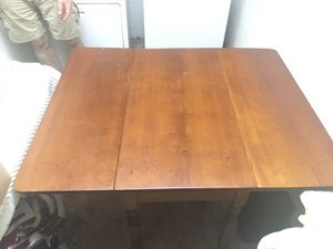 Solid wood drop leaf table.