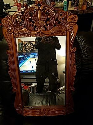 There's some nice hand carved cherry wood made mirror is very beautiful