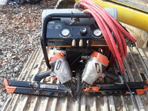 RIDGID AIR COMPRESSOR AND TWO FRAIMING GUNG PASLODE