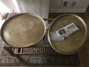 Two large brass trays