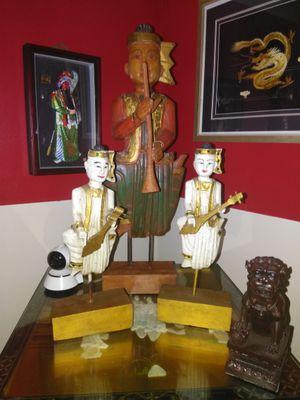 Three hand carved vintage Indonesian Mandalay