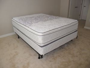 New in the plastic queen size pillowtop mattress and box spring