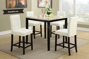 Counter High Table set with White chairs... $449.99 Free delivery.. Please visit (iNeedBed. info) for more details