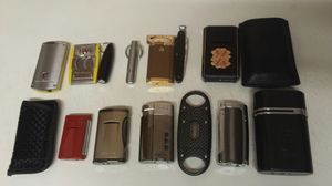 Cigar cutters and lighters