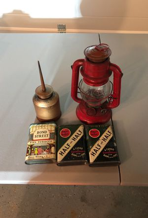 Lamp oil can and tobacco tins