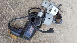 Black and Decker 1/2 inch drill with assorted hole saws.