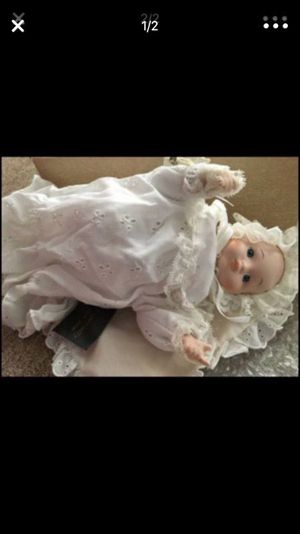 The baby porcelain doll is a wind up musical doll. Great Baby present, new still in the box $20