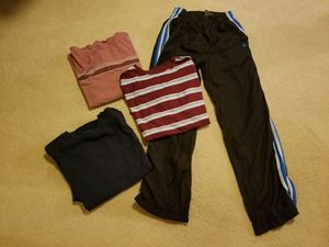 Size 14/16 boys 3 tee shirts 1 jogging pants Preowned