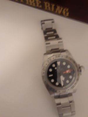 Rolex watch black dial beautiful but needs a cleaning