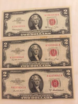 1953 a red note, 1963 red note and 1976 note $2 bills