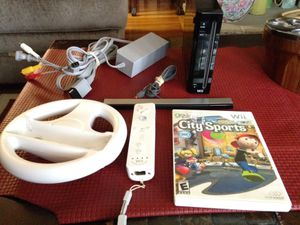 Wii console, 1 game, controller, sensor and wire attachments