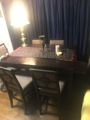 Extendable Malaysian wood table and (6) chairs