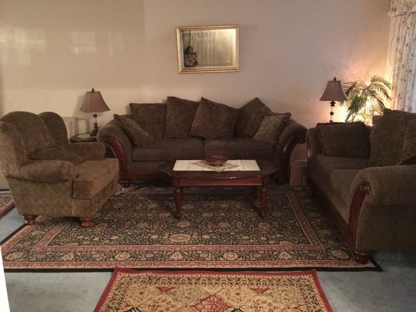 Sofa set with tables and lamps