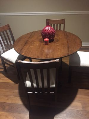Wood round table and 4 chairs