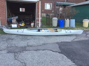 2 and 1/2 person kayak with life vests and 3 paddles