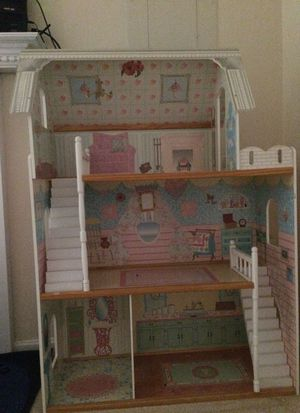 Wooden Barbie house a lot furnitures ... almost new