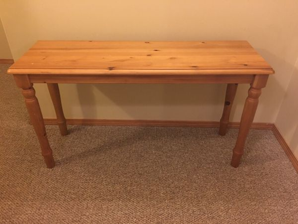 knotty pine entertainment or clothing armoire and matching sofa table