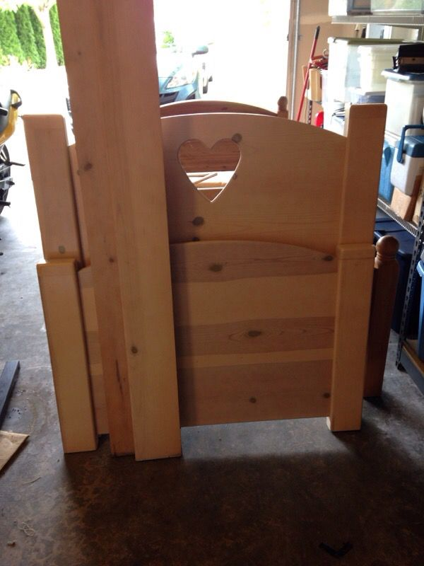 Cute wooden twin bed frame with cut out heart furniture for Cute twin bed frames