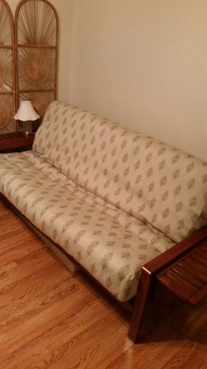 Full size futon bed/sofa w/cover.