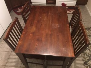 Wooden brown table with four chairs