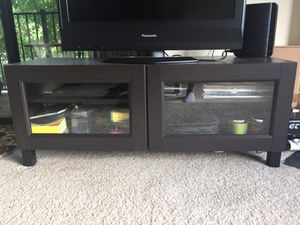 BESTA TV unit with glass doors and 4 legs