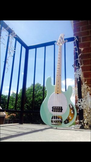 Bass guitar- Sterling by Musicman SUB Ray 4 Bass in Mint Green