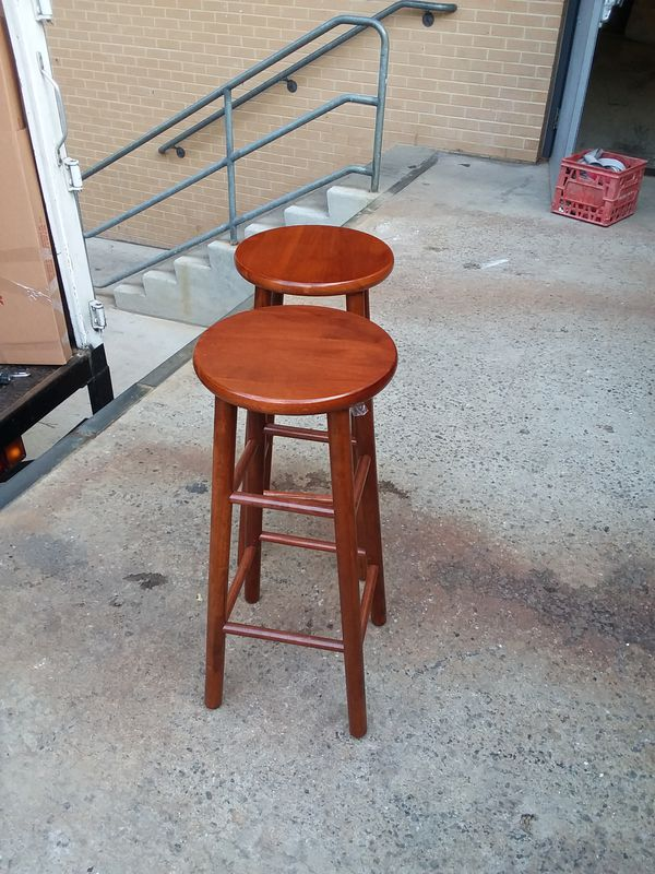 Two brown stools