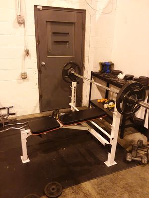 Weight bench with barbell and 280lb weights