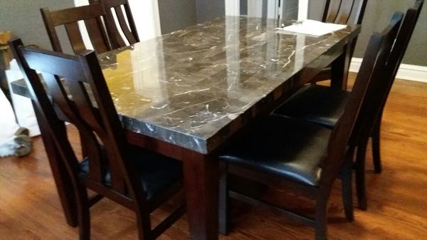 brand new dining table with 6 chairs and matching hutch