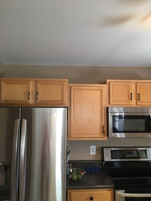 Kitchen cabinets. Uppers and lowers- includes crown molding, all hardware and counter tops.