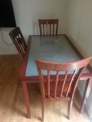 Dinner table with three chairs for 85.00 only.