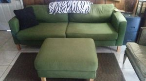 Green couch and ottoman