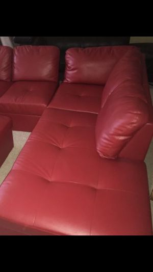Brand new red faux leather sectional with ottoman