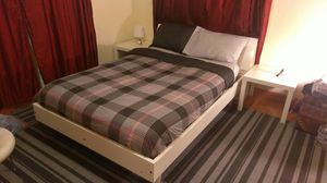 Full size bed have storage and new mattress and 2 night stand