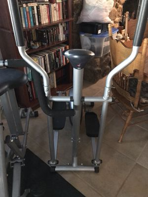 Brand New never Black and gray elliptical trainer