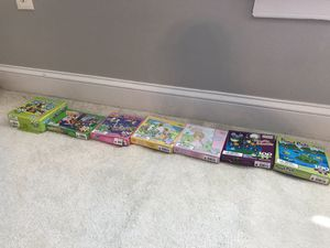 Seven 100 piece puzzles some brand new