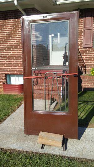 Brown storm door good condition.