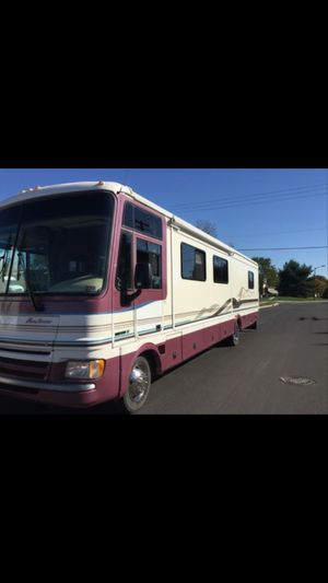 High selling a 1999 Pace Arrow 37 ft S by Fleetwood this RV is like new 22.000miles everything works perfect runs and drives ready to go camping