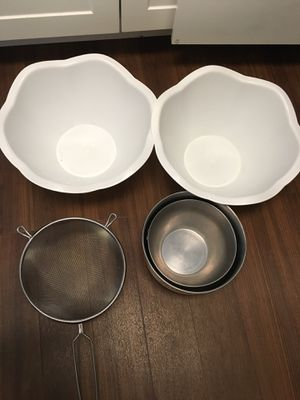 Two stainless steel and two plastic balls and stainless steel strainer