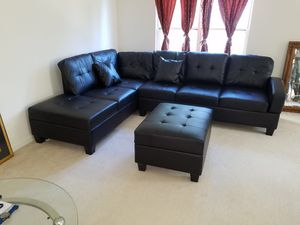 Brand new black leather sectional with ottoman