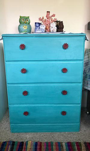 Vintage turquoise dresser with red accent knobs